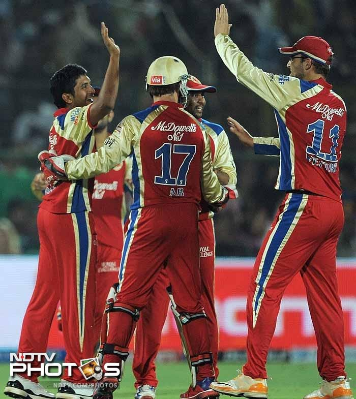 Bangalore players celebrate their 46-run win against Rajasthan. (AFP PHOTO/ MANAN VATSYAYANA)