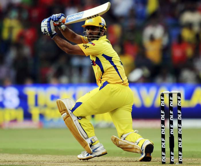 Chennai Super Kings captain Mahendra Singh Dhoni plays a shot during the IPL Twenty20 match against Royal Challengers Bangalore at the M.Chinnaswamy Stadium in Bangalore. (AFP PHOTO)