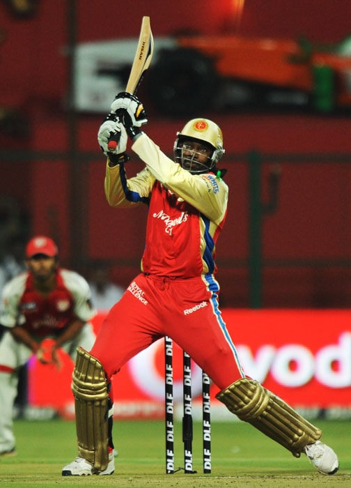 Royal Challengers Bangalore batsman Chris Gayle plays a shot during the IPL Twenty20 cricket match against Kings XI Punjab at the M.Chinnaswamy Stadium in Bangalore. (AFP PHOTO)