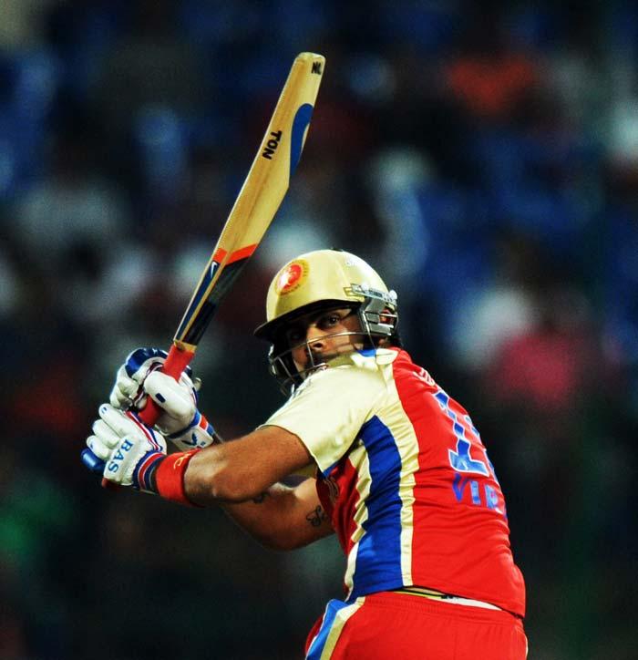 Royal Challengers Bangalore batsman Virat Kohli plays a shot during the IPL Twenty20 cricket match against Kings XI Punjab at the M.Chinnaswamy Stadium in Bangalore. (AFP PHOTO)