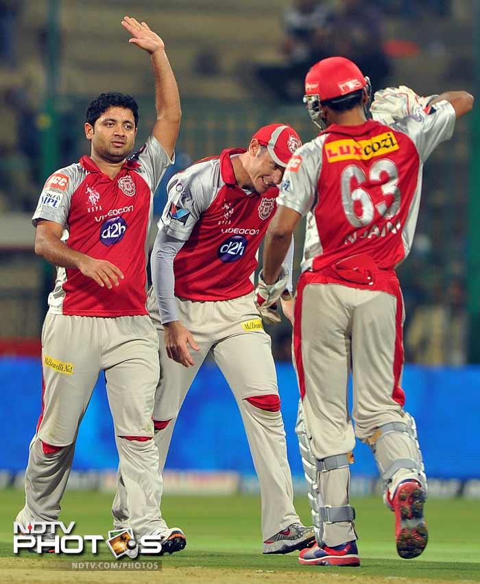 Chris Gayle and Virat Kohli's departure in quick succession put the brakes on Bangalore's run-rate. Piyush Chawla picked up Virat Kohli. (AFP PHOTO/Manjunath KIRAN)
