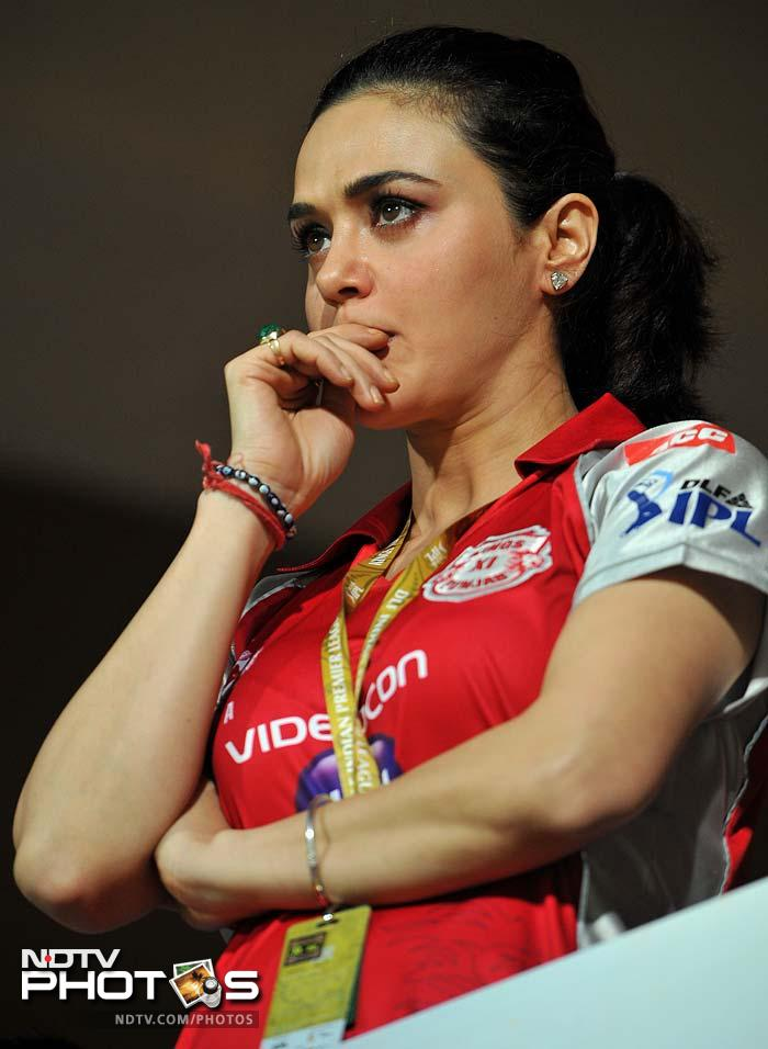 Kings XI Punjab almost threw away the match giving its owner Preity Zinta some anxious moments. (AFP PHOTO/Manjunath KIRAN)