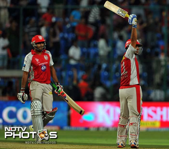 Royal Challengers Bangalore's up-and-down run in the fifth edition of the Indian Premier League continued with a four-wicket defeat at home to Kings XI Punjab. (AFP PHOTO/Manjunath KIRAN)