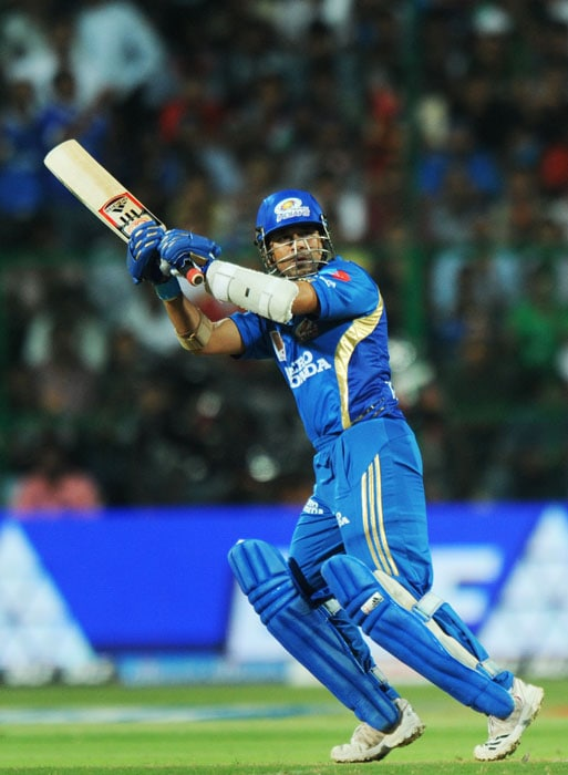 Mumbai Indians captain Sachin Tendulkar plays a shot during the IPL Twenty20 match against Royal Challengers Bangalore at the M.Chinnaswamy Stadium in Bangalore. (AFP PHOTO)