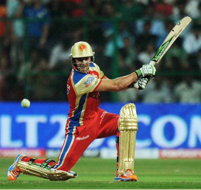 Royal Challengers Bangalore batsman AB de Villers plays a shot during the IPL Twenty20 cricket match against Mumbai Indians at the M.Chinnaswamy Stadium in Bangalore. (AFP PHOTO)