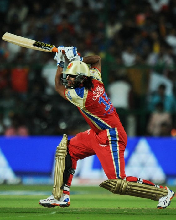 Royal Challengers Bangalore batsman Saurabh Tiwary plays a shot during the IPL Twenty20 cricket match against Mumbai Indians at the M.Chinnaswamy Stadium in Bangalore. (AFP PHOTO)