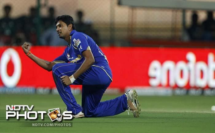 Rajasthan Royals bowler Siddharth Trivedi celebrates after taking the wicket of Royal Challengers Bangalore batsman AB de Villiers (not seen) during their Indian Premier League (IPL) cricket match in Bangalore. (AP Photo/Aijaz Rahi)