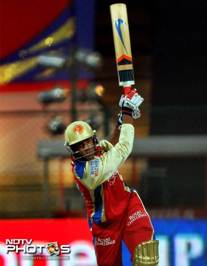 Royal Challengers Bangalore batsman Mayank Agarwal hits a six during the IPL Twenty20 cricket match against Rajasthan Royals at the M. Chinnaswamy Stadium in Bangalore. (AFP PHOTO/Manjunath KIRAN)