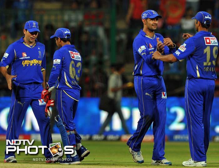 Ajinkya Rahane (103), Owais Shah (60) and Siddharth Trivedi (4 wickets) all chipped in for Rajasthan Royals who crushed Royal Challengers Bangalore by 59 runs in Match 18 of IPL 5 at Bangalore. (AFP PHOTO/Manjunath KIRAN)
