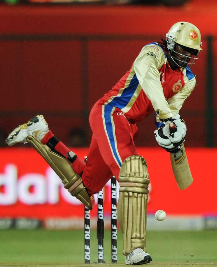 For Chris Gayle though, rain or no rain, he had one plan in mind as always; to hit the ball as hard as possible. He survived a couple of top edges to ultimately end with a score of 38 off just 12 balls. (AFP Photo)