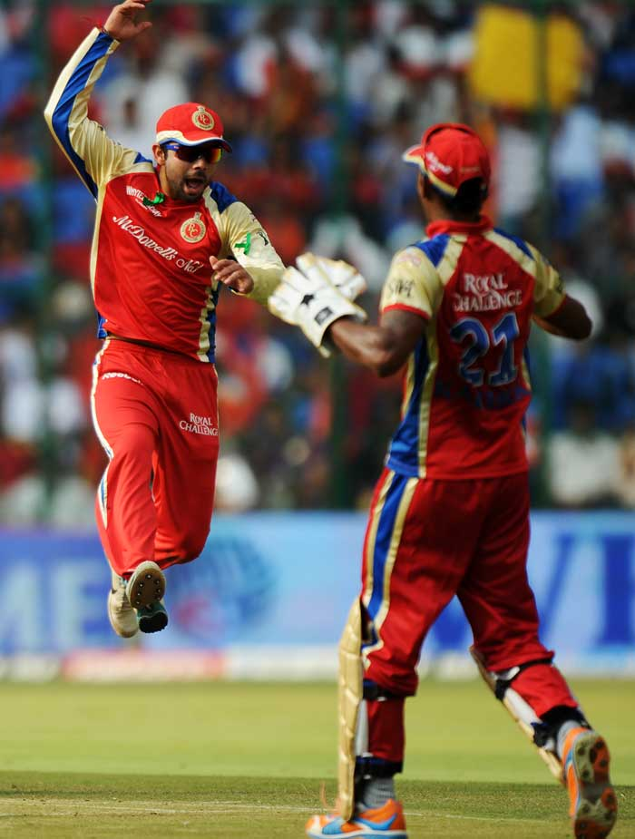 The Bangalore contingent would have been pretty happy with the proceedings, especially because a shorter game meant that Chris Gayle's early surge could pave the way for an easy victory. (AFP Photo)