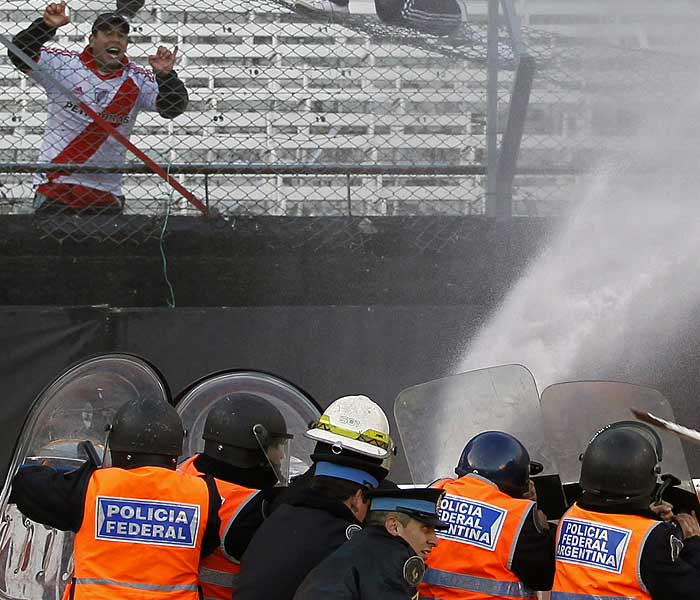 Fans were also seen ripping up stadium seats and using them as weapons in fights inside the venue.Half a half dozen ambulances entered the stadium area about 45 minutes after the match ended, with live television coverage showing medics working on the injured while street fights erupted just a few feet away. (AP Photo)