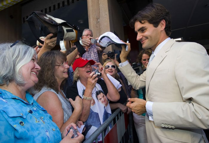 "World number one tennis player Roger Federer signs autographs prior the unveiling of a plate bearing his name at the Basel ""Hall of Fame"" in Basel. (AFP Photo)"