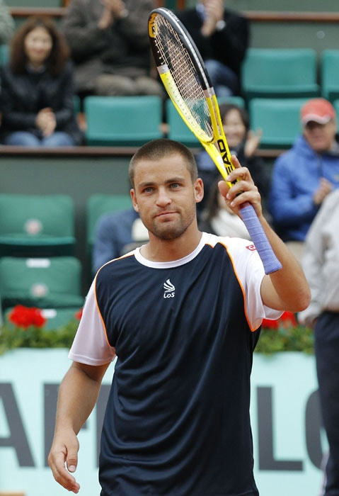 Russia's Mikhail Youzhny gestures at the end of his men's fourth round match.(AFP PHOTO)
