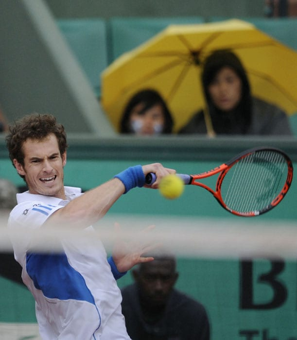 Great-Britain's Andy Murray plays a shot during his men's fourth round match. (AFP PHOTO)