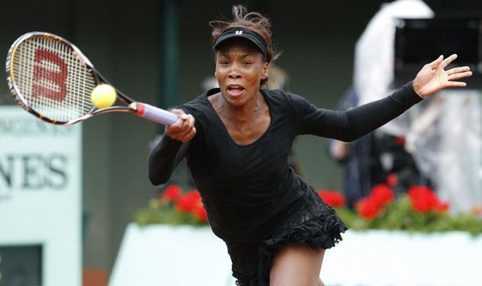 Venus Williams returns the ball to Russia's Nadia Petrova. (AFP PHOTO)