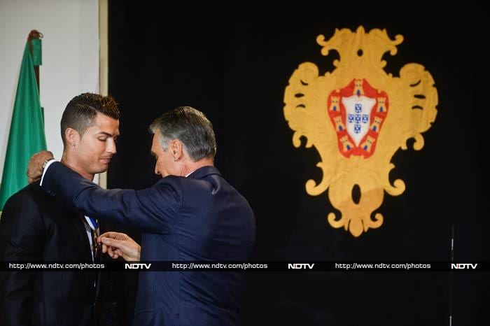 Portuguese forward and winner of the 2014 FIFA Ballon D'Or, Cristiano Ronaldo, was honoured by Portugal President Anibal Cavaco Silva. <br><br>All images courtesy AFP.