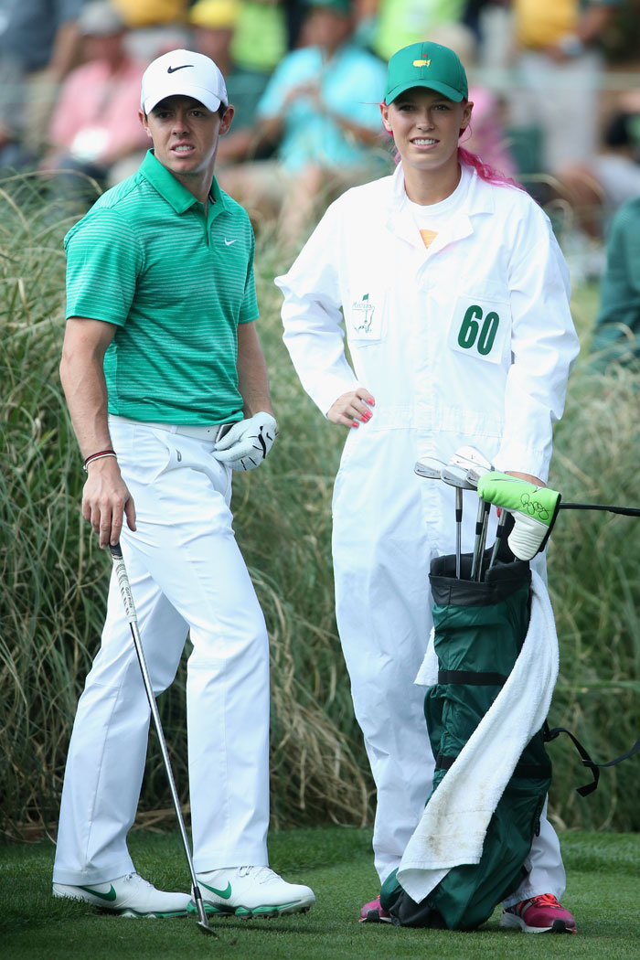Wozniacki was all-smiles as she carried boyfriend and fiancee Rory McIlroy's kit bag around during the Augusta Masters in the US.