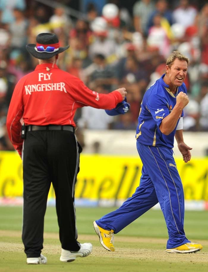 Shane Warne won the toss and opted to field first on a green top. Here he exults after taking a wicket despite a good start made by the Deccan Chargers. (AFP Photo)