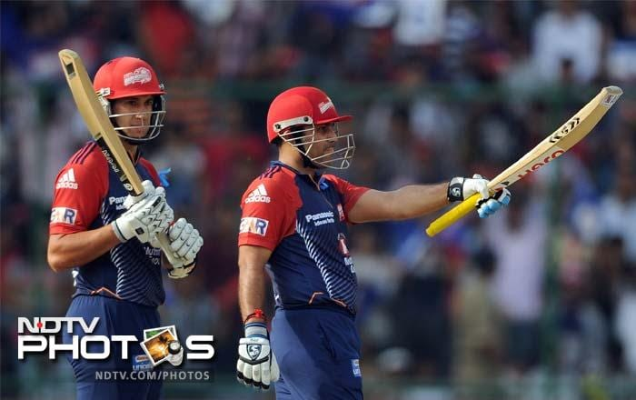 Delhi's innings was steadied by skipper Virender Sehwag (right) who hit a furious 39-ball 63. (AFP PHOTO/ Prakash SINGH)