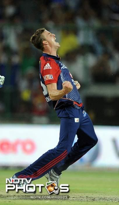 Morne Morkel bowled a remarkable 19th over which cost three runs and had the bonus wicket of Brad Hodge. It left 12 needed off the final over. (AFP PHOTO/ Prakash SINGH)