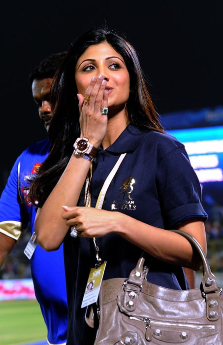 Rajasthan Royals cricket team owner and Indian actress Shilpa Shetty gestures to spectators prior to the IPL Twenty20 match against Chennai Super Kings at the Swai Mansingh Stadium in Jaipur. (AFP PHOTO)