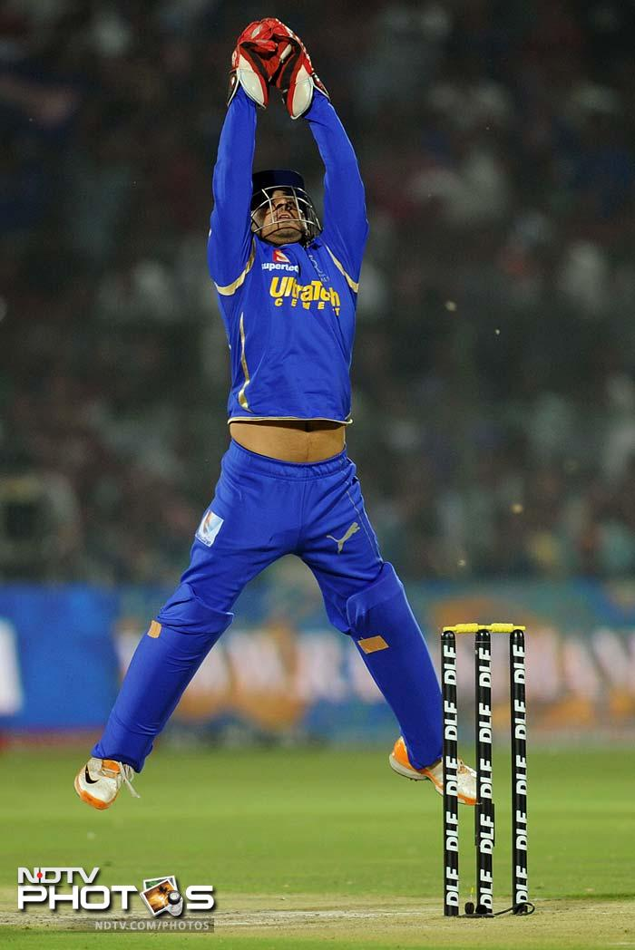 Rajasthan Royals wicketkeeper Shreevats Goswami receives a throw during the IPL Twenty20 cricket match against Delhi Daredevils at the Sawai Mansingh stadium in Jaipur. (AFP PHOTO/SAJJAD HUSSAIN)