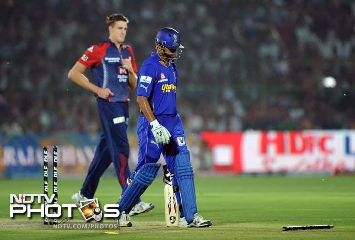 Rajasthan Royals captain Rahul Dravid (R) walks back to the pavillion after he was dismissed by Delhi Daredevils bowler Morne Morkel during the IPL Twenty20 cricket match at the Sawai Mansingh stadium in Jaipur. (AFP PHOTO/SAJJAD HUSSAIN)
