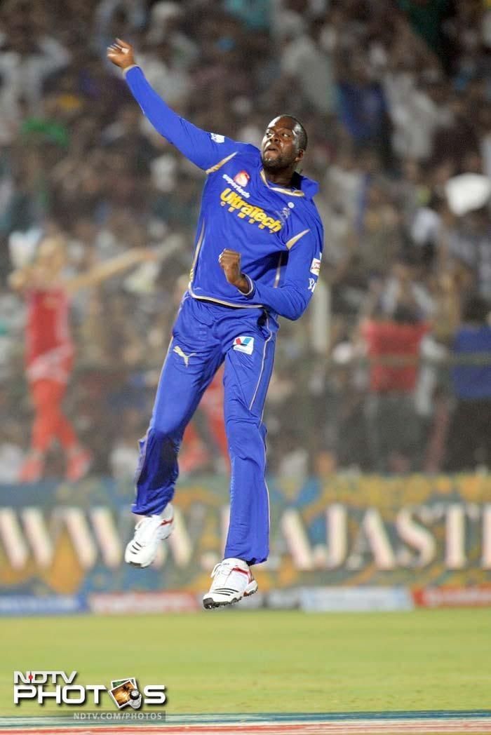 Rajasthan Royals bowler Kevon Cooper celebrates after striking the wicket of Kings XI Punjab batsman Shaun Marsh during the IPL Twenty20 cricket match at the Sawai Mansingh Stadium in Jaipur. (AFP PHOTO/RAVEENDRAN)