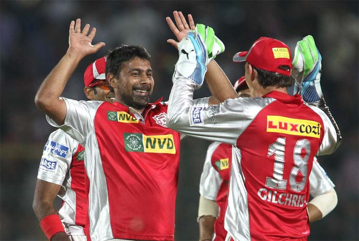Praveen Kumar brought the Kings XI back into the game after dislodging Rahul Dravid (9) and Stuart Binny (0) in quick succession. With Watson out early, Rajasthan were three down for 58, giving Punjab the license to tighten the screws. (BCCI image)