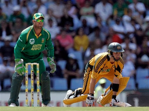 Callum Ferguson, right, falls on the ground as he runs whilst Mark Boucher, left, looks on during the second ODI match at the SuperSport Park in Pretoria on Sunday, April 5, 2009. (AP Photo)