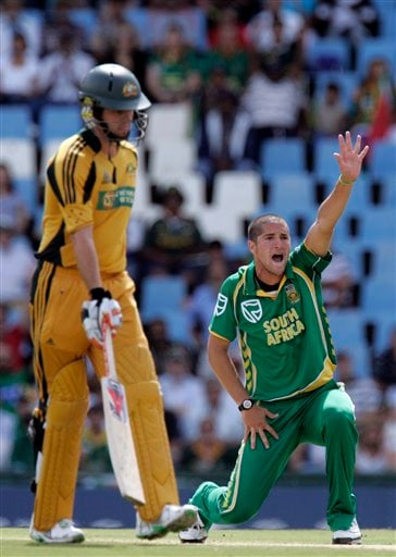Wayne Parnell, right, appeals successfully for a LBW to dismiss Australia's batsman Michael Hussey, unseen, as teammate Callum Ferguson, left, looks on for 3 runs during the second ODI match at the SuperSport Park in Pretoria on Sunday, April 5, 2009. (AP Photo)