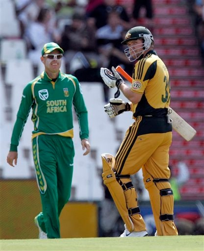 James Hopes, right, leaves the crease as South Africa's Johan Botha, left, looks on after his dismissal for 8 runs during the second ODI match at the SuperSport Park in Pretoria on Sunday, April 5, 2009. (AP Photo)