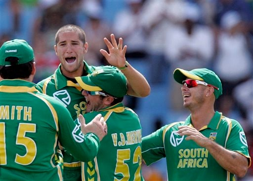 Wayne Parnell, second from left, celebrates with teammates after a successful appeal for a LBW to dismiss Michael Hussey, unseen for 3 runs during the second ODI cricket match at the SuperSport Park in Pretoria on Sunday, April 5, 2009. (AP Photo)