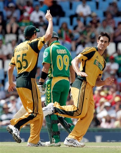 Mitchell Johnson, right, celebrates with teammate Ben Laughlin, left, after dismissing Herschelle Gibbs, center, for 2 runs during the second ODI match at the SuperSport Park in Pretoria on Sunday, April 5, 2009. (AP Photo)