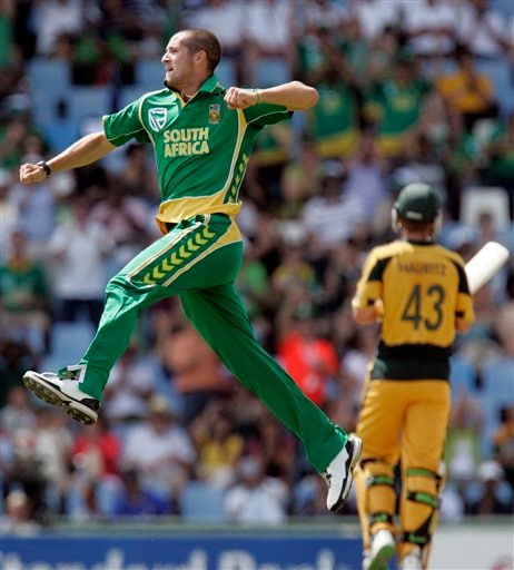 Wayne Parnell, left, celebrates after dismissing Nathan Bracken, unseen, as teammate Nathan Hauritz, right, looks on during the second ODI match at the SuperSport Park in Pretoria on Sunday, April 5, 2009. (AP Photo)