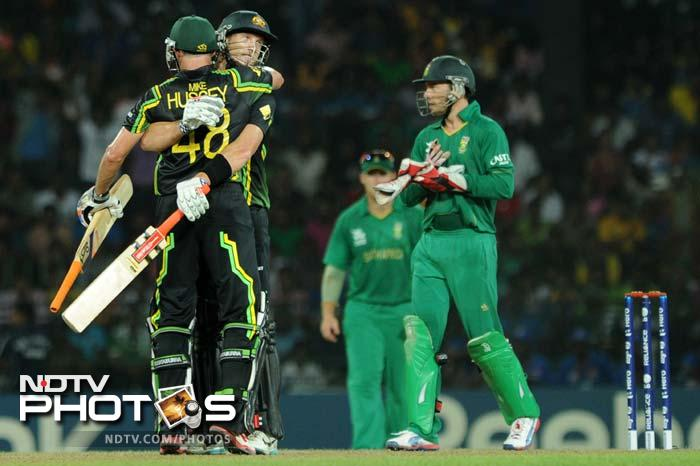 Australia sailed to victory with 14 balls to spare and moved closer to a semi-final berth.