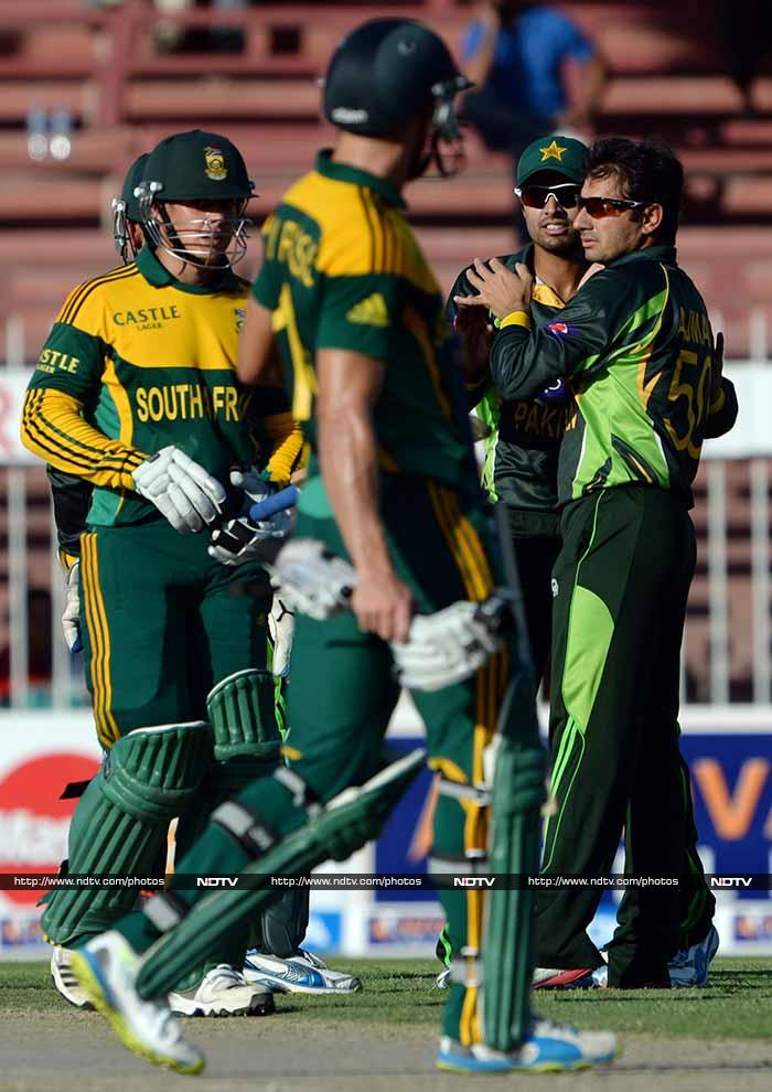 For Pakistan, Saeed Ajmal claimed three wickets including that of de Kock (in pic).