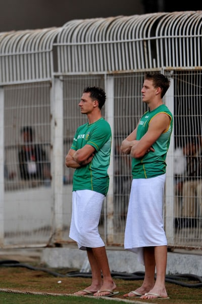 Dale Steyn and Morne Morkel watch captain Graeme Smith during the first day of the two-day warm-up match against Board President XI at Nagpur. (AFP Photo)