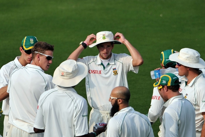 South African cricketers gather during a break on the first day of the two-day warm-up match against Board President XI. (AFP Photo)