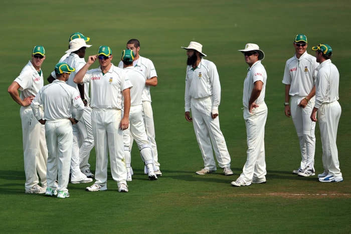 The South African cricket team waits for the batsman to arrive during the first day of a two-day warm-up match against Board President XI at Nagpur. (AFP Photo)