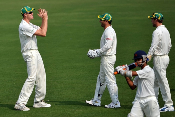 Morne Morkel gestures as wicketkeeper Mark Boucher looks on during the first day of a two-day warm-up match against Board President XI at Nagpur. (AFP Photo)