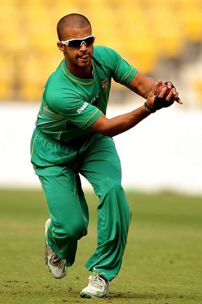 Jean-Paul Duminy takes a catch during a practice session in Nagpur. (AFP Photo)