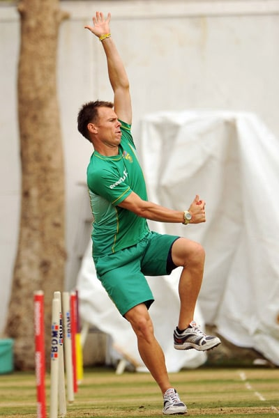 Johan Botha bowls at the net during a practice session in Nagpur. (AFP Photo)