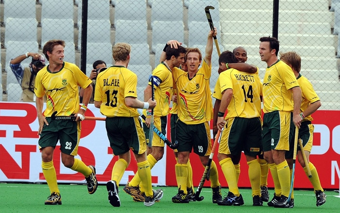 South African hockey players celebrate a goal against Spain during their hockey World Cup 2010 match at the Major Dhyan Chand Stadium in New Delhi. (AFP Photo)