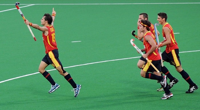 Spanish hockey player Rodrigo Garza (#18, L) celebrates after scoring a goal during their hockey World Cup 2010 match at the Major Dhyan Chand Stadium in New Delhi. (AFP Photo)