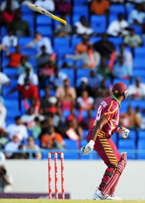 West Indies cricketer Kieron Pollard loses his bat playing a shot off South African bowler Dale Steyn. Pollard made 12 runs. (AFP PHOTO)