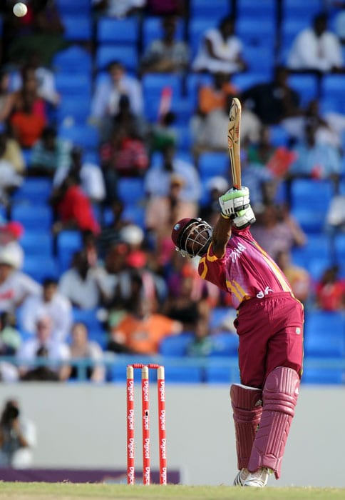 West Indies cricketer Dwayne Bravo hits a boundary off South African bowler Lonwabo Tsotsobe.West Indies won the toss and chose to field first. (AFP PHOTO)
