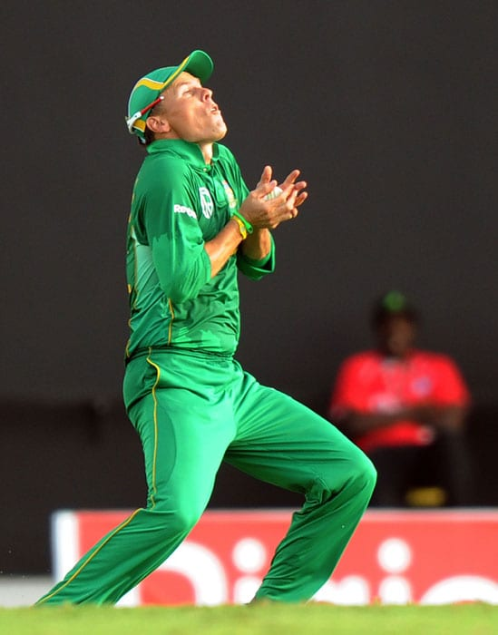 South African Johan Botha grips a catch to dismiss West Indian Dwayne Bravo. West Indies scored 119 in their 20 overs and lost by 1 run. (AFP PHOTO)