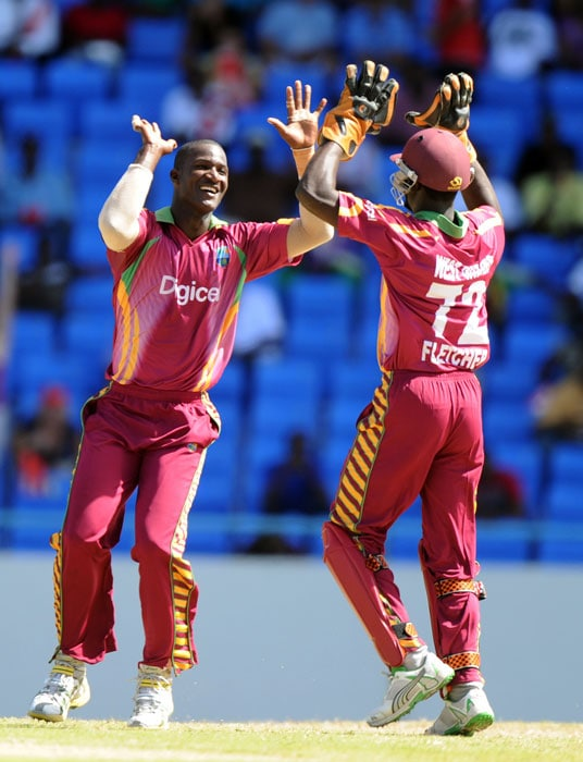 West Indies cricketer Darren Sammy celebrates with wicketkeeper Andre Fletcher after dismissing South African batsman Jean-Paul Duminy.Duminy made 13 runs.(AFP PHOTO)